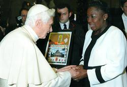 Pope Benedict XVI greets Rebecca Kadaga.