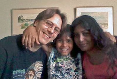Domenic Johansson, with his parents.